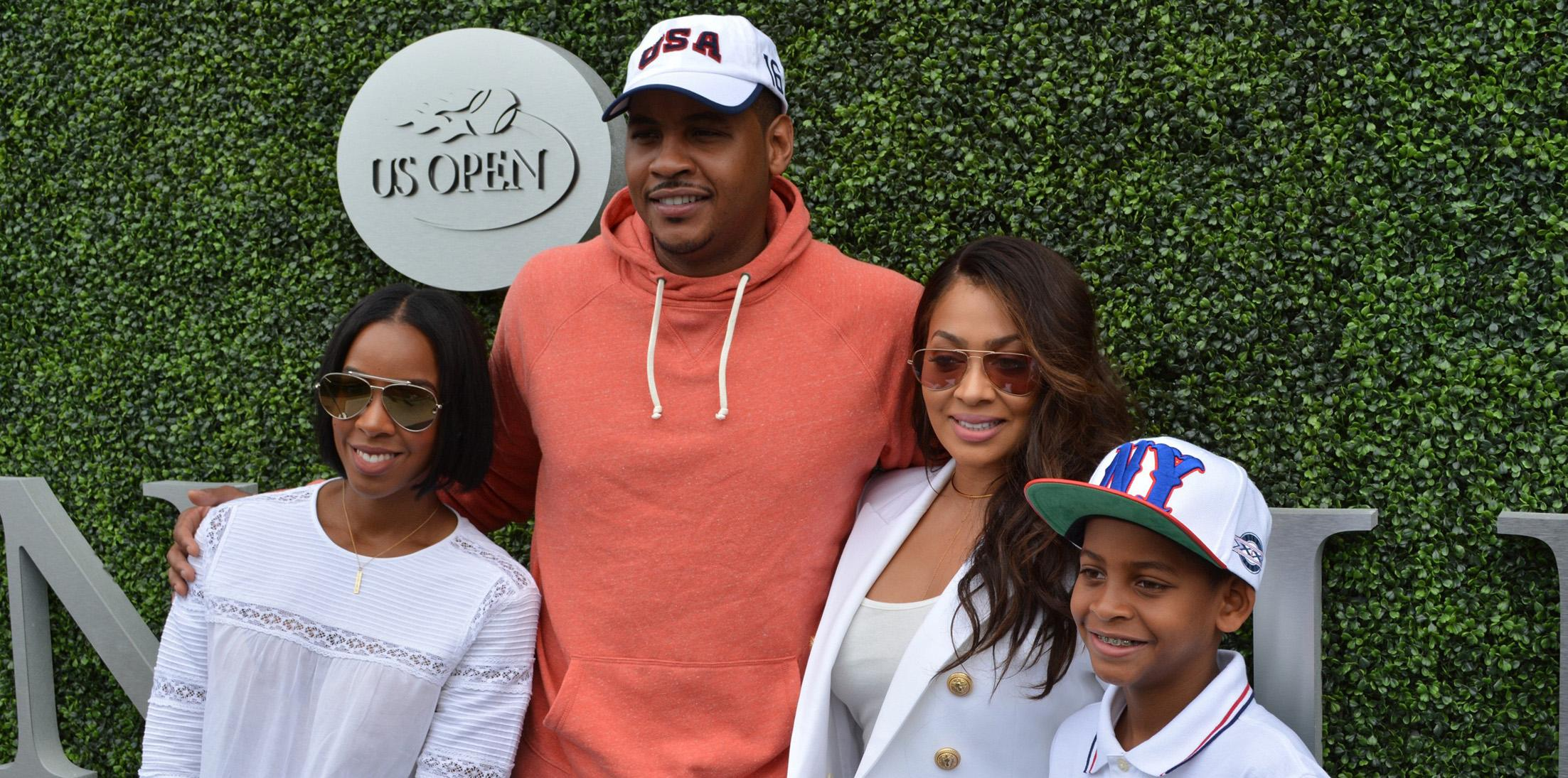 Kelly Rowland poses for pictures with Carmelo Anthony and his family