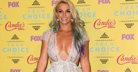 Britney Spears poses in the press room at the Teen Choice Awards 2015