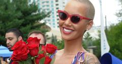 amber rose with sunglasses and flowers