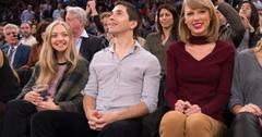 Justin Long shares a strange, funny moment with his girlfriend Amanda Seyfried and singer Taylor Swift as they are shown on the big screen as they attend tonights Knicks game at Madison Square Garden