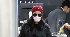 Angela Simmons Wears Face Mask At Airport Amid Coronavirus Outbreak