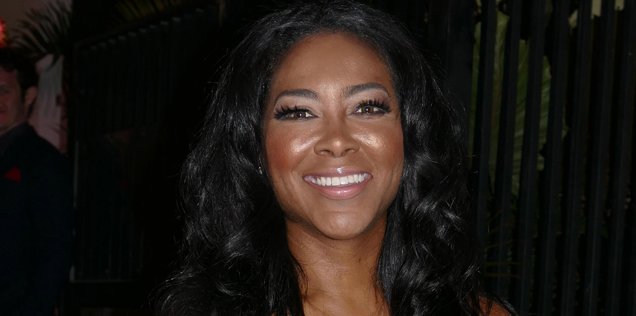 *EXCLUSIVE* Kenya Moore poses for pictures as she leaves a party in Miami