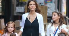 Jessica Alba hides her baby bump under a black dress during lunch with her daughters