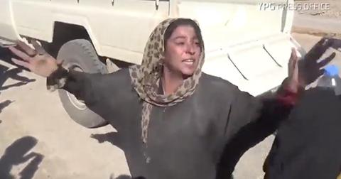 Women tears off burqa isis rescued feaature
