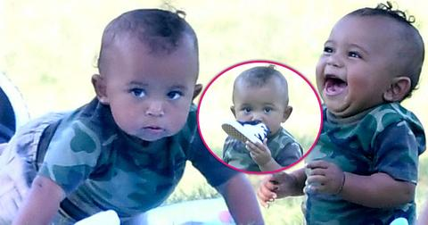 saint west smelling shoe laughing having fun in the park