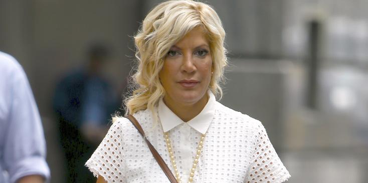 Tori Spelling Poses With Mickey Mouse In NYC