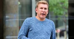 TV personality and real estate broker Todd Chrisley and his son, Chris Chrisley, check out of Trump Soho Hotel on May 15, 2015 in New York City