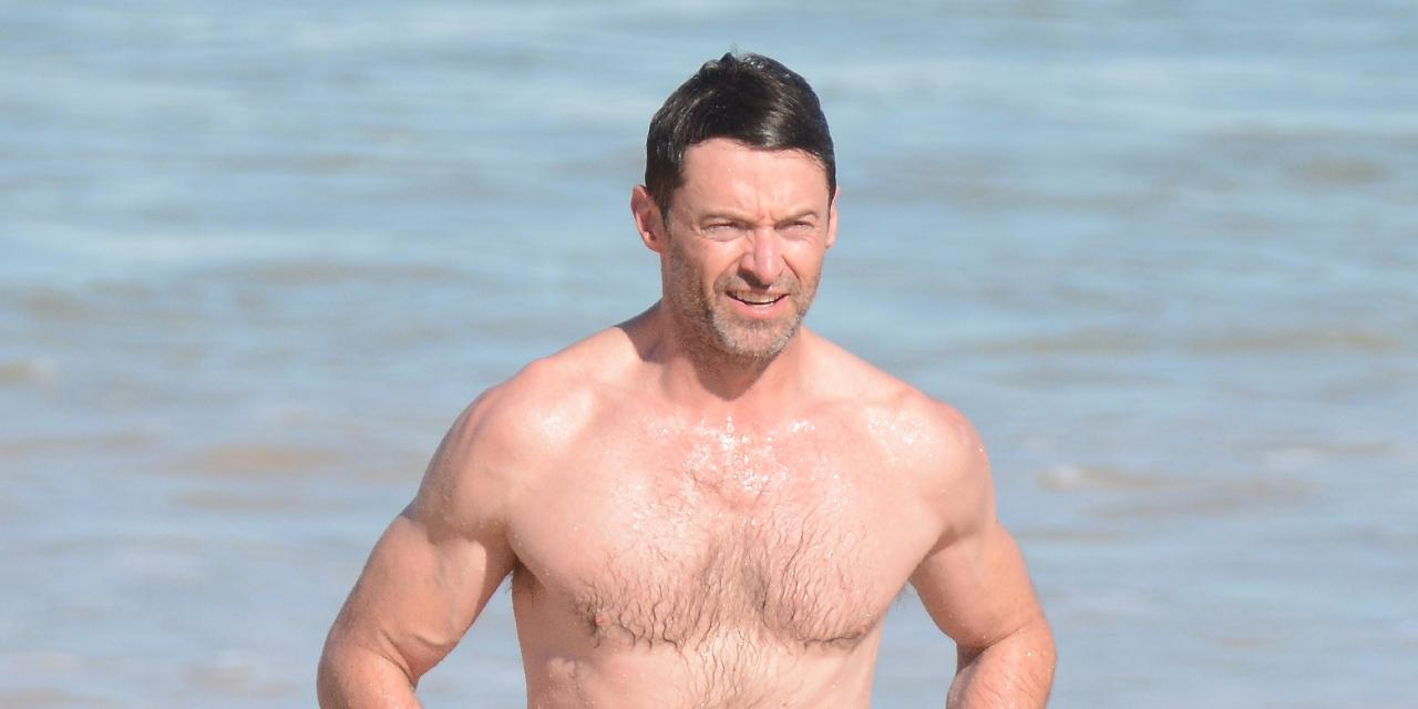 Hugh Jackman goes for a swim at Bondi ahead of concert.