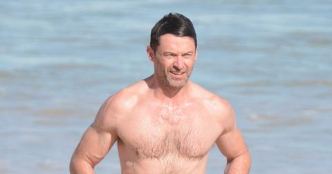 Hugh Jackman goes for a swim at Bondi ahead of concert.