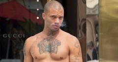 EXCLUSIVE: 'Hot Felon' Jeremy Meeks takes a shirtless stroll in Cannes.