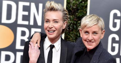 Portia De Rossi Wearing White Dress Shirt With Black Tie and Tuxedo Jacket Standing With Ellen Degeneres Wearing Black Dress Shirt and Black Crystal Studded Jacket
