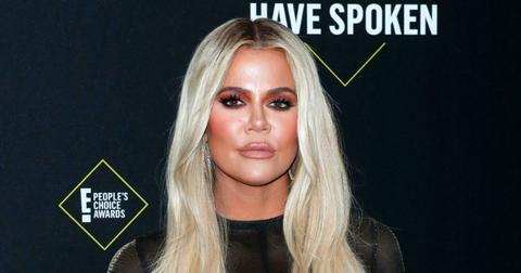 Khloe Kardashian wore a black, see-through, blouse with her hair dyed platinum blonde.