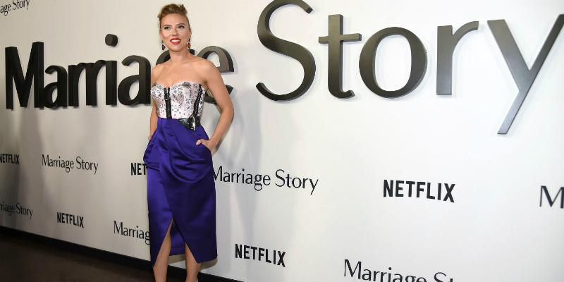 Scarlett Johannson dazzles the red carpet in a purple and white dress.