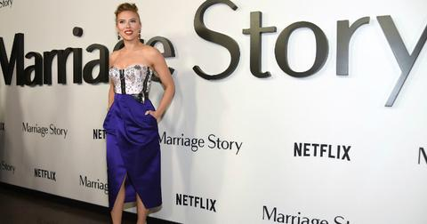 Scarlett Johannson dazzles the red carpet in a purple and white dress.