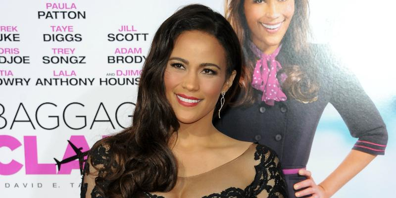 Paula Patton in a black dress on the red carpet.