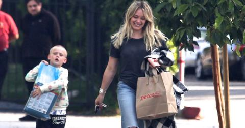 *EXCLUSIVE* Hilary Duff gets some help from Luca carrying the dog food