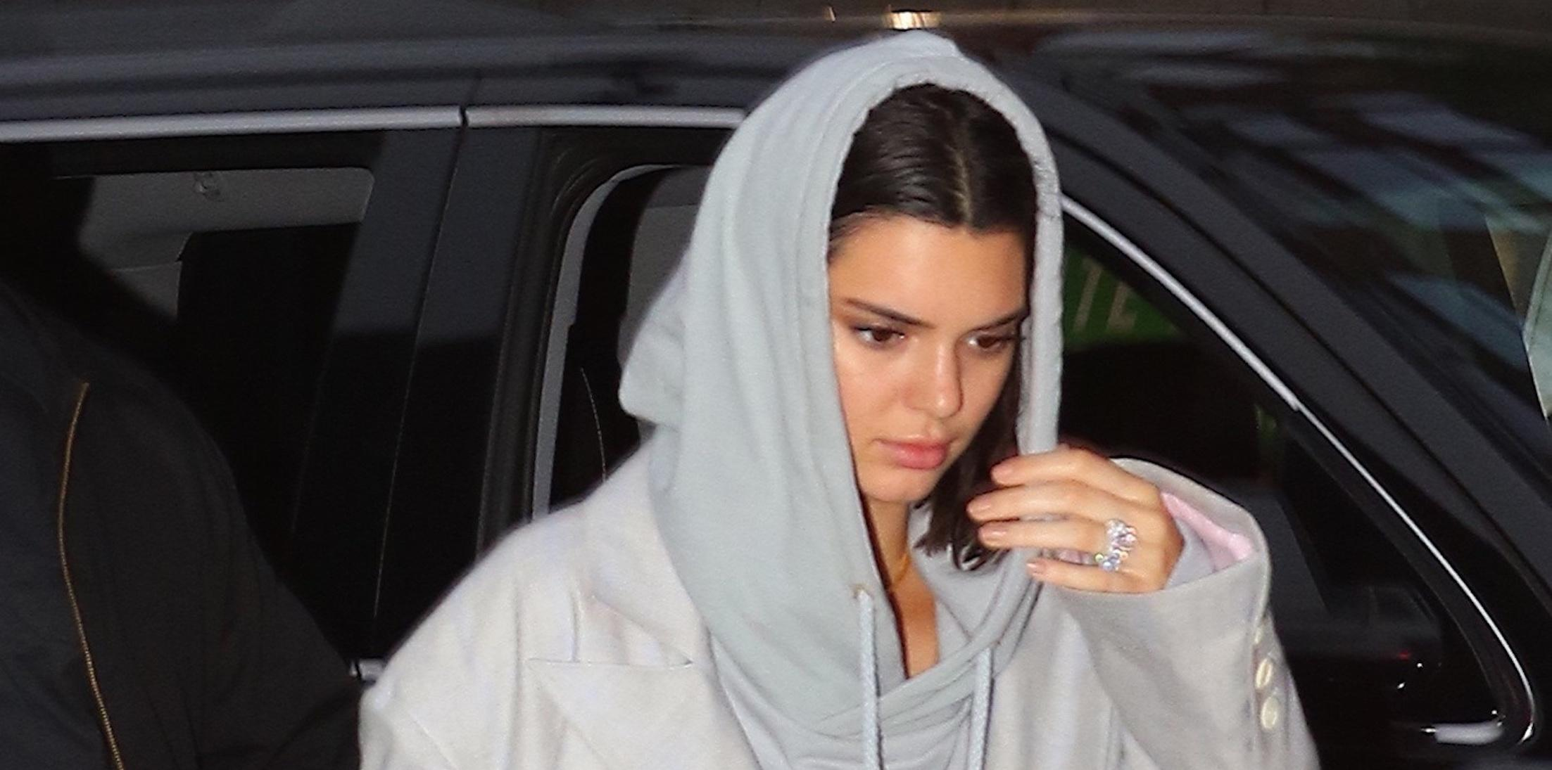 Kendall Jenner shows off a diamond ring on her engagement finger while out with ASAP Rocky