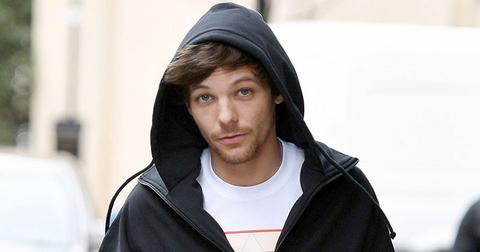Louis tomlinson airport fight arrested hit fan hr