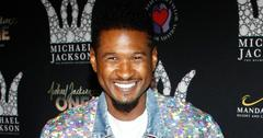 Usher Smiling At An Event