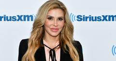 Brandi Glanville wears a black top with strings tied in a bow over a pink top in this 2018 SiriusXM Studios visit.