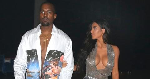 EXCLUSIVE: Kim Kardashian shows off her curves as she holds Kanye West as they get close and walk together backstage at the American Airlines arena in Miami