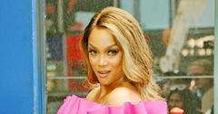 Tyra Banks Wearing a Pink Dress