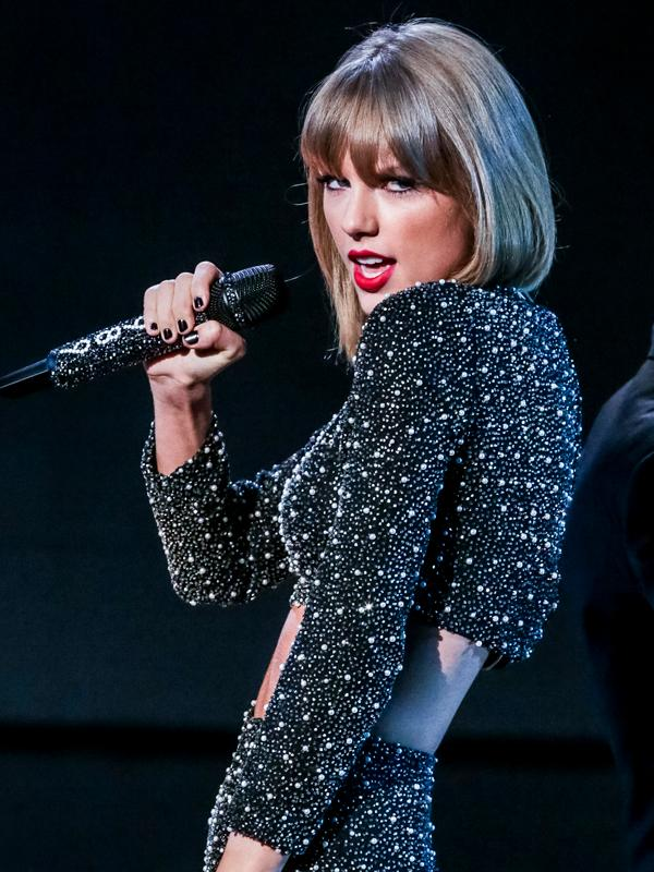 Pharrell Williams and Taylor Swift seen performing on The X Factor results show