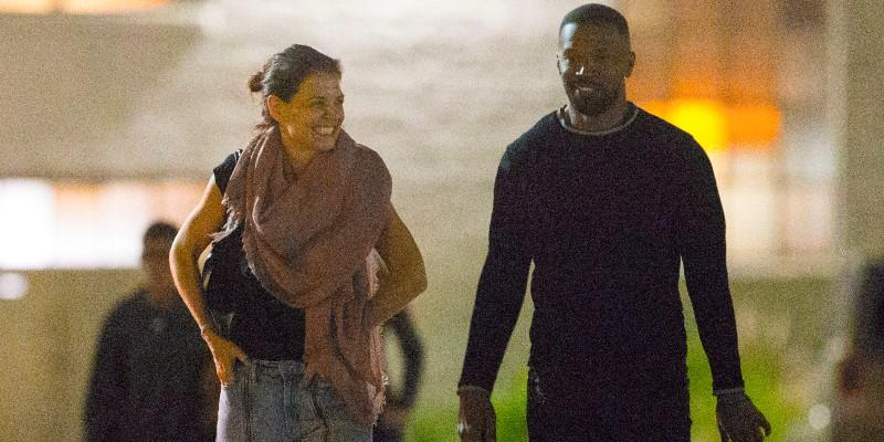Katie Holmes and Jamie Foxx have a blast on the beach.