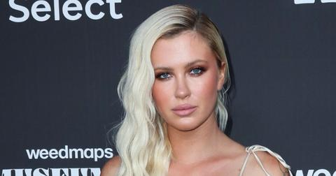 Ireland Baldwin Wearing Her Hair Down in A white Dress On a Red Carpet