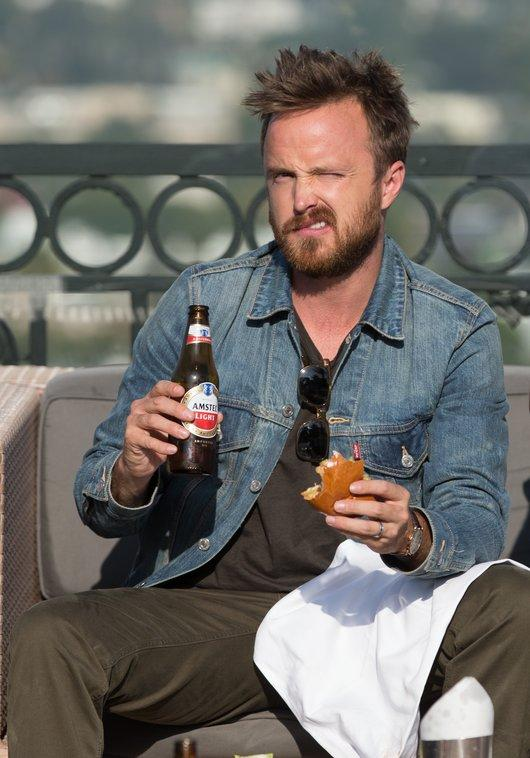EXCLUSIVE: 'Breaking Bad' star Aaron Paul celebrates the show's record breaking return with a beer and a burger