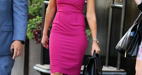 Actress Jessica Alba, wearing a fuchsia dress, leaves Trump Soho Hotel on September 10, 2014 in New York City