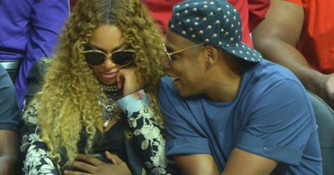 Excited parents Beyonce and Jay Z get distracted by their unborn twins at the LA Clippers game