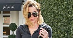 Khloe Kardashian shows off her curves in athleisure as she arrives to Epione
