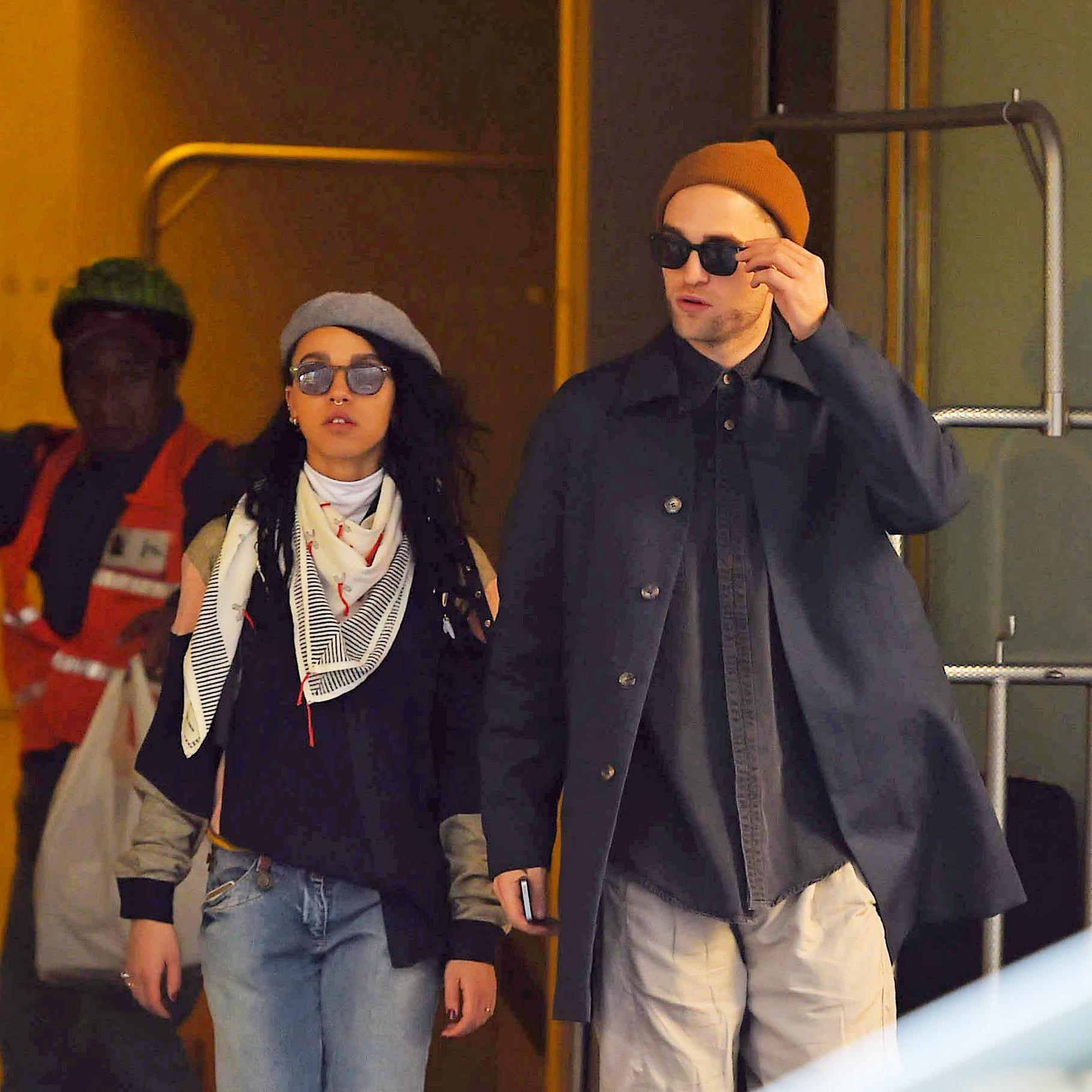 Robert Pattinson and his girlfriend FKA twigs get a taxi cab in Midtown Manhattan