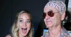Jennifer Lawrence, in a sleeveless dress, met Bill Murray, who sported a flowery bandana and tan jacket.