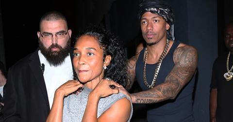 Nick Cannon puts his hands on TLC singer Rozonda Thomas' shoulders as they leave Warwick nightclub together in Hollywood