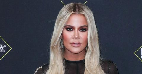 Khloe Kardashian Wearing a Black Dress On a Red Carpet