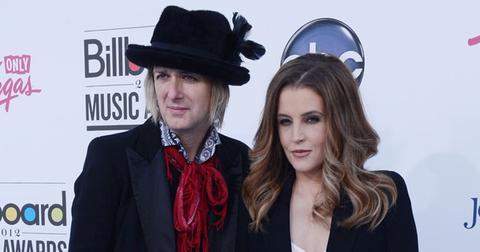 Michael Lockwood Wearing Hat and Lisa Marie Presley wearing Black