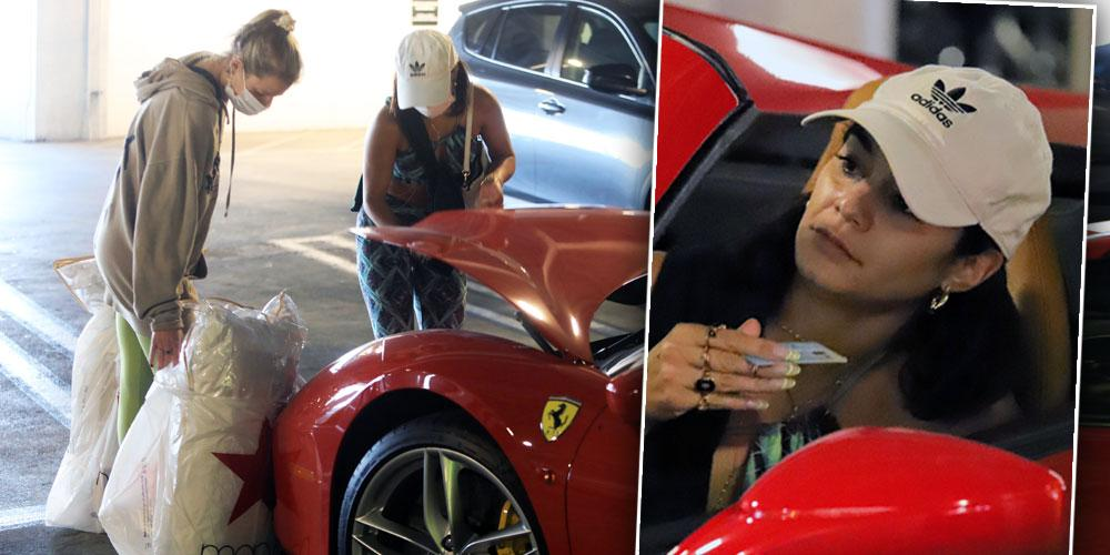 Vanessa Hudgens stuffs her Ferrari after early holiday shopping at the mall.