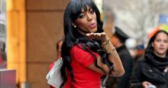 Porsha Williams spotted in a plunging red dress while blowing kisses to the paparazzi in New York City