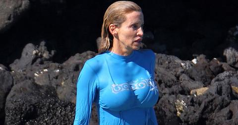 EXCLUSIVE: Real Housewives of Beverly Hills star Camille Grammar wears a skin tight top and bikini bottoms on vacation in Hawaii.
