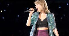 Taylor swift onstage with a bare midriff