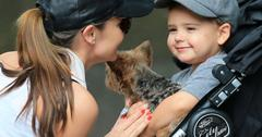 Flynn Bloom hugs and kisses his puppy Frankie while mom Miranda Kerr looks on tenderly in Central Park, NY