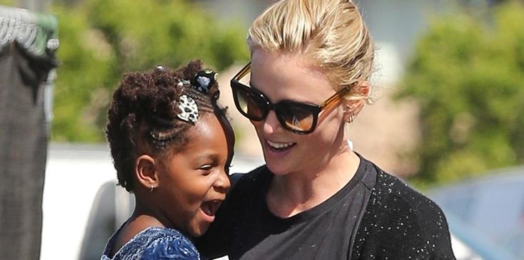 Charlize theron says adoption lowest point elle interview