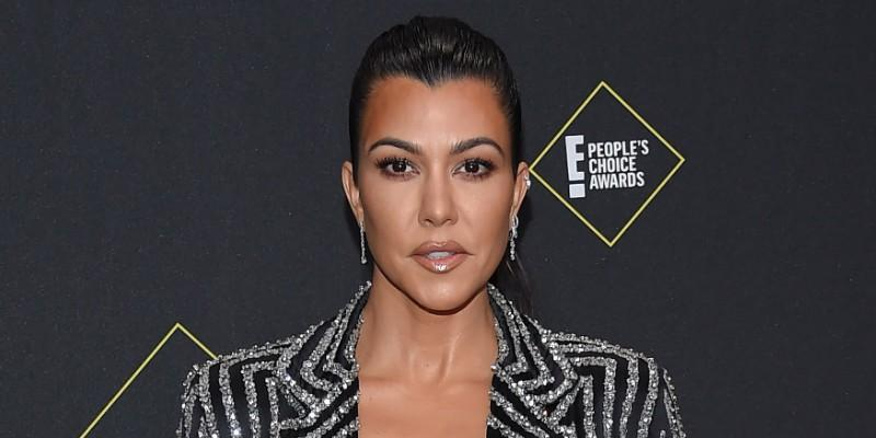 Kourtney Kardashian Wearing a Striped Suit on The Red Carpet