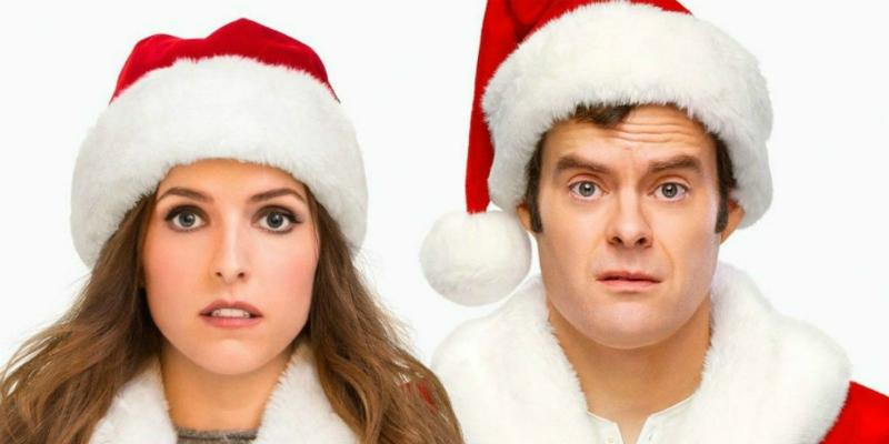 Anna Kendrick and Bill Hader, both in Santa hats, in a scene from Disney's Noelle.