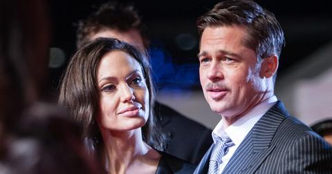 (FILE PHOTO) Brad Pitt and Angelina Jolie on red carpet in Japan