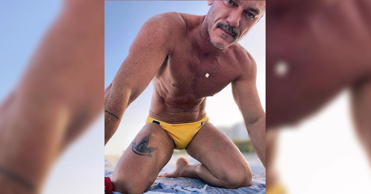 luke evans debuts leg tatoo pp