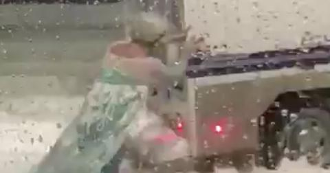 Drag elsa frees stuck police wagon blizzard boston video