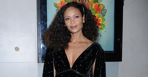 Thandie newton deep cut black gown cinched waist main